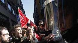 Picketers and protesters clash with police