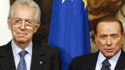 Newly appointed Prime Minister Monti poses with his predecessor Berlusconi at Chigi palace in Rome