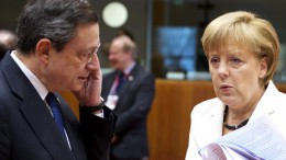 Mario Draghi with Angela Merkel