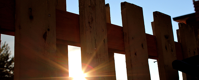 A fence at sunset