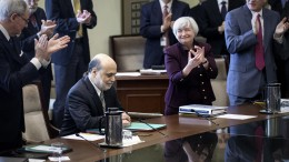 Chairman Ben S. Bernanke receives a standing ovation at the Board meeting in Washington, D.C. on January 27, 2014.