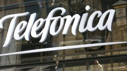 Reflections are seen on a logo of Spain's telecommunications giant Telefonica in Madrid