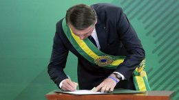Rightist Bolsonaro takes office in Brazil, promising populist change to angry voters